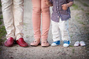 shoes and sneakers of parents and elder brother and expected bab