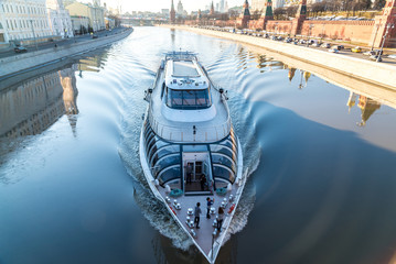 The ship sails along the river near Kremlin in Moscow, Russia