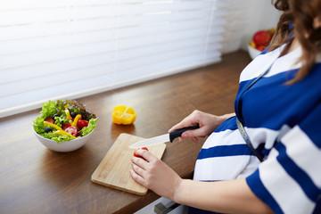 Cutting vegetables for salad