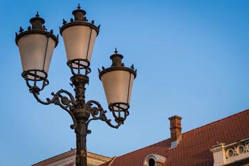 Three armed lamp post