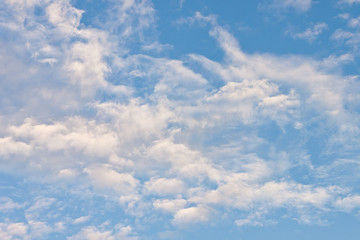 Texture of fluffy white cloud on bright blue sky