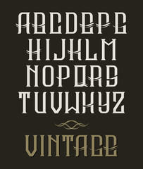 Hand drawn vector vintage typeface. Old style font on dark background