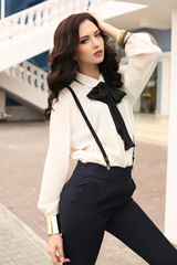 gorgeous sensual woman with dark hair in elegant clothes