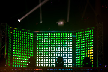 Led spotlights screen of green colors. Concert stage decoration