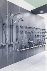 Plumbing shop interior, bath shower on the wall