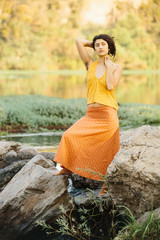 Young Hippie Woman with Natural Hairy Armpits in Nature
