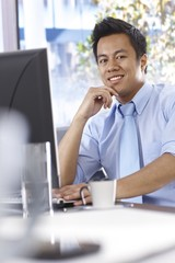 Happy businessman working with computer