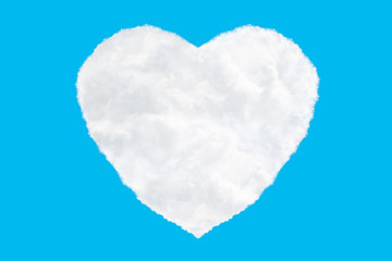 one heart shaped clouds on blue