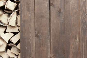 Wooden wall near stack of firewood.