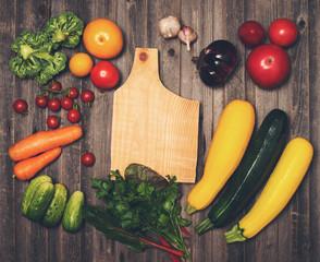 Retro styled vintage food background. Fresh vegetables and ingredients