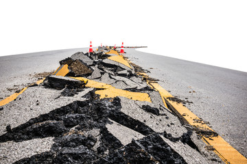 cracked asphalt road with marking lines and  orange-white stripe safty cones on white background, selective focus,