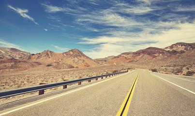 Retro stylized empty road, travel concept.