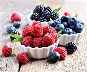 Mix of berries on wooden board.