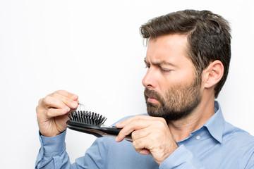 Man watching at hair brush