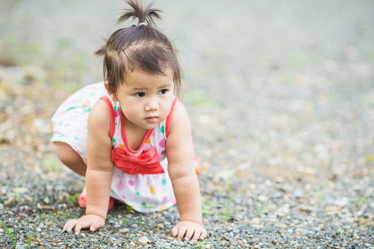 a baby learning to walk.Slips and falls are a normal part of a child's development.