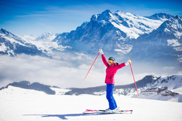Young woman skiing in the mountains.