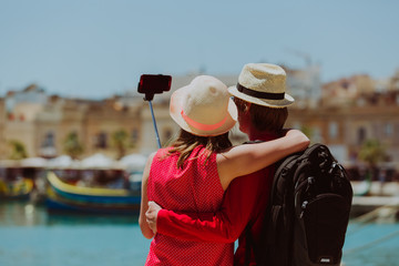 young couple travel in Europe making selfie