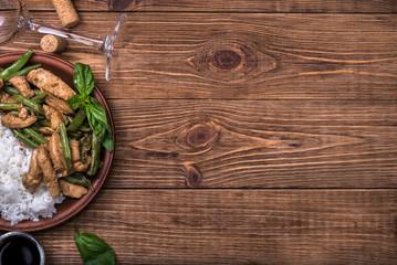 Keuken foto achterwand Koken Chicken with asparagus and rice.