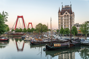 Zelfklevend Fotobehang Rotterdam Rotterdam City, Oude Haven oldest part of the harbour, historic ship yard dock, Old Ship, Openlucht Binnenvaart Museum, Haringvliet and the Willemsbrug bridge at Dusk in Summer, Netherlands