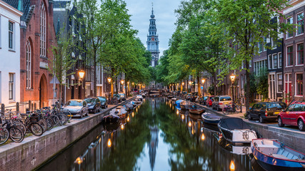 Spoed Fotobehang Amsterdam Amsterdam City, Illuminated Building and Canal at night, Netherlands
