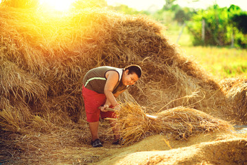 a farmer boy play in the rice field.