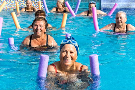 Group of senior women at aqua gym session.