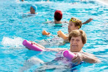 Senior female aqua gym session.