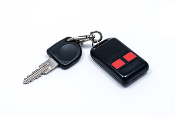 Old car key with car alarm remote control isolated on white background