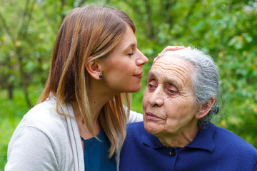 Kissing grandma's forehead