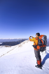 Winter hiking in the mountains with a backpack.