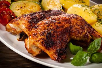 Roast chicken leg and vegetables