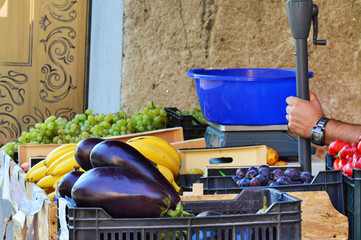 Grocery stand on the street with fresh vegetables and fruits.