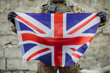 Soldier holding British flag