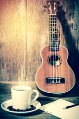 coffee cup and coffee beans and Ukulele with papernote,for backg