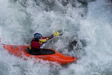 Red Kayak in white rapids