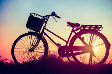 Landscape picture Vintage Bicycle with Summer grass field at sun