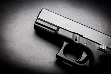 hand gun on black background