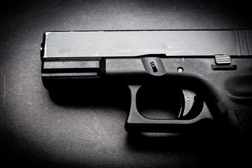 hand gun on black background