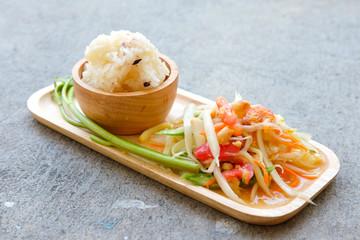 Papaya salad Thailand food call Som Tum Thai with sticky rice
