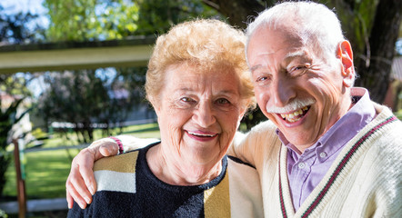 Happy senior couple relaxing outdoor on a sunny day