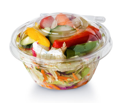 fresh vegetable salad in a plastic package,  isolated on white b