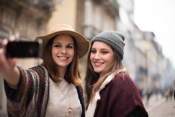 Women taking selfies