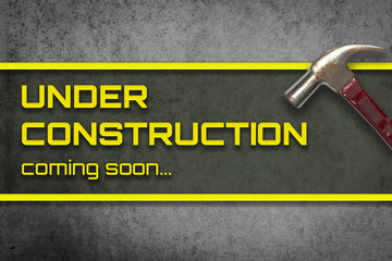 Under construction grungy hammer banner for webpage