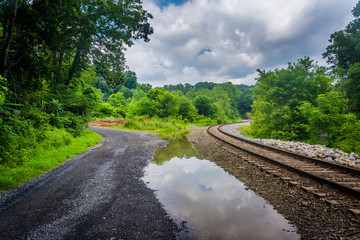 Dirt road and railroad track in rural Carroll County, Maryland.