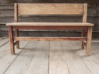 Old wooden bench on the wooden floor.