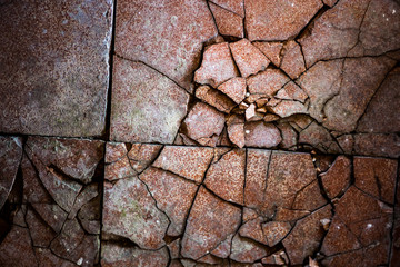Surface of the old and damaged tiles
