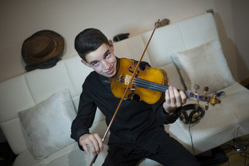 Teen playing a violin
