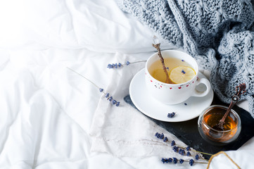 Warm knitted sweater,cup of hot tea