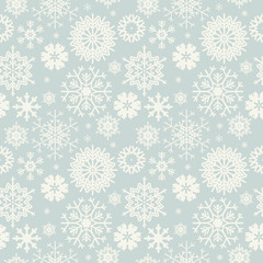 Cute seamless pattern with snowflakes isolated on light blue bac