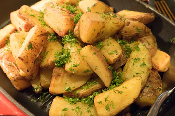 saute Herbed Potato in a pan
